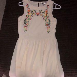 A cream colored dress.